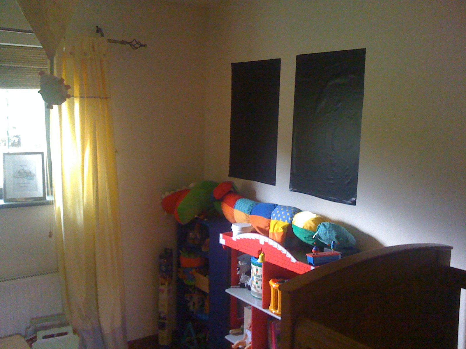 Magic Blackout Blind stuck to a wall in nursery when not in use on window